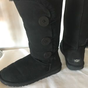 """Black tall UGG """"Bailey button triplet"""" boot."""